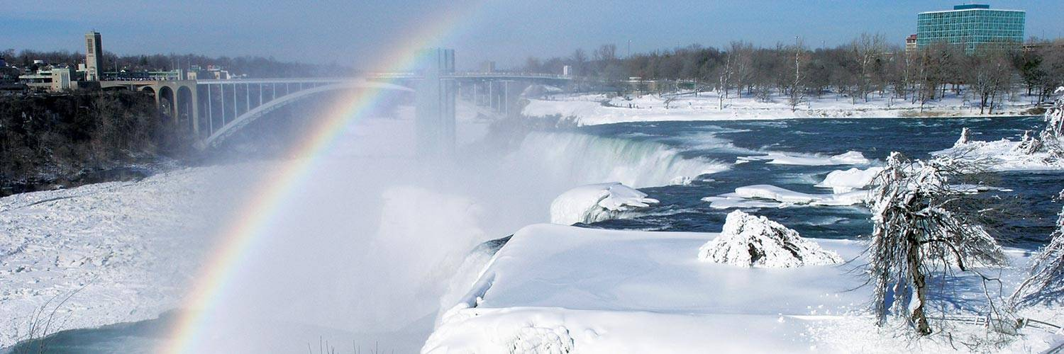 View of the American Falls with a rainbow at Niagara Falls State Park in the winter