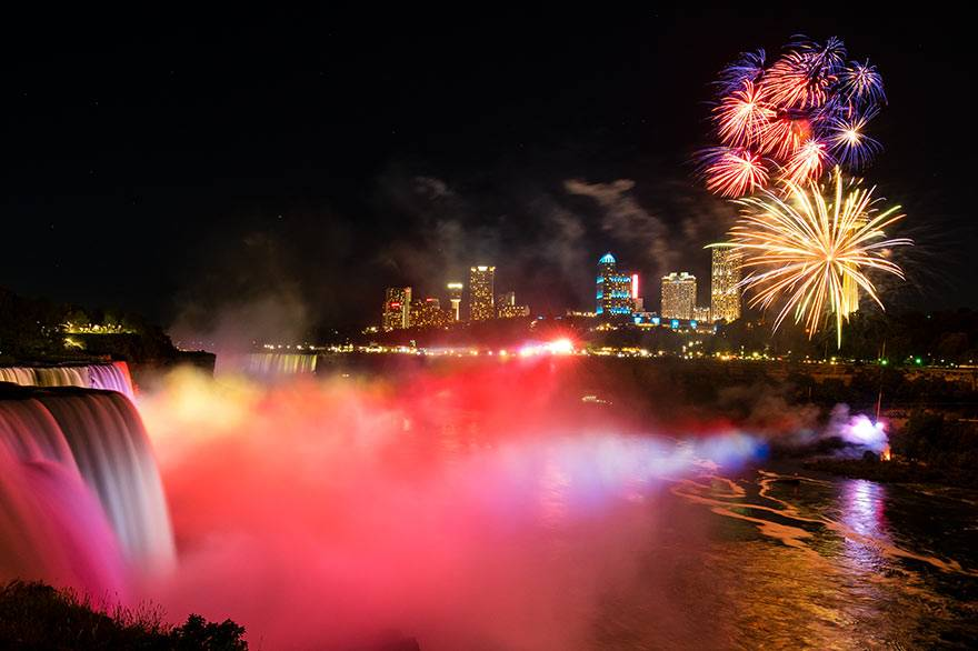 Fireworks light up the sky over Niagara Falls at night