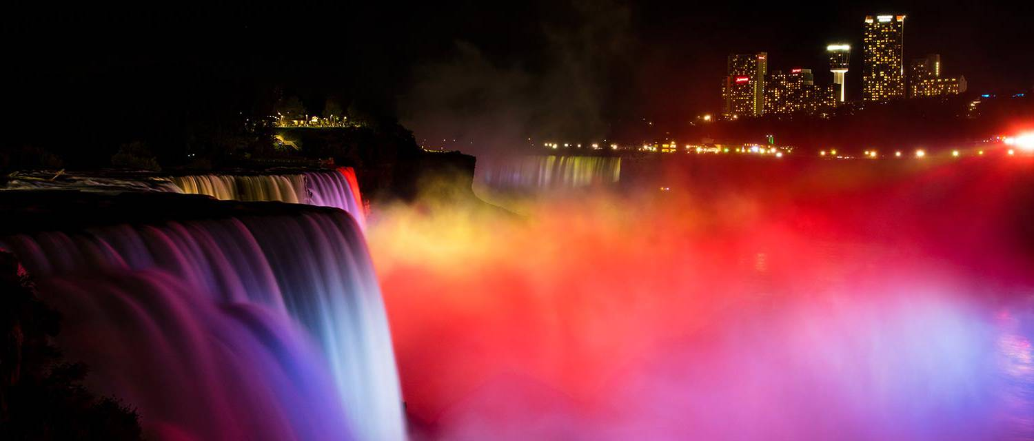 Niagara Falls illuminated at night with lights