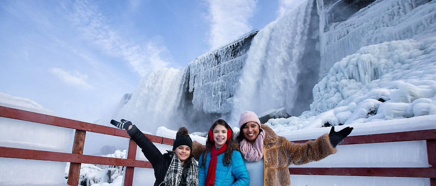 A family exploring Niagara Falls in winter