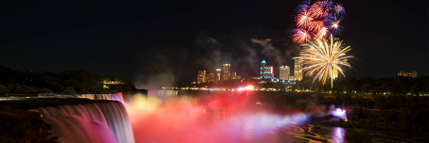 fireworks over niagara falls at night